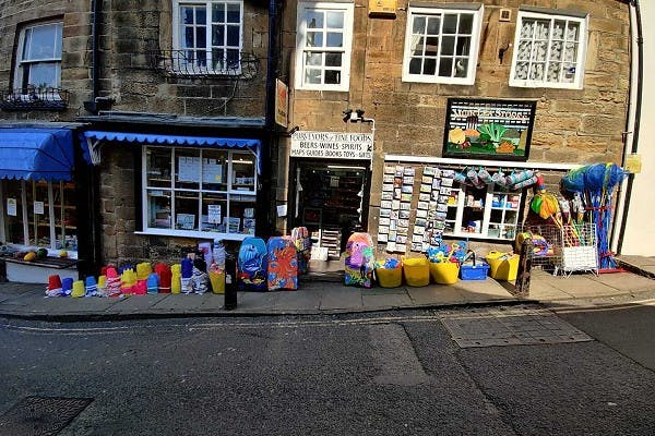 Outside photo of Muir Lea Stores with products on the pavement