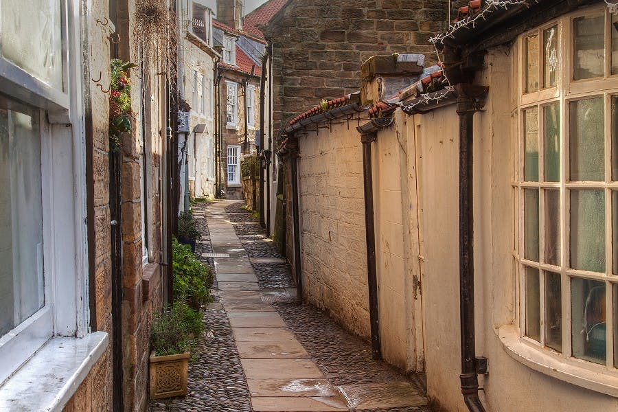 Narrow alleyway between lovely small cottages